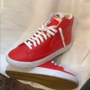 Brand new red Nike high tops.
